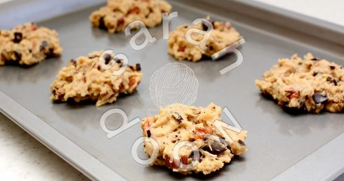 Baking pecan and chocolate chip cookies - stock photos