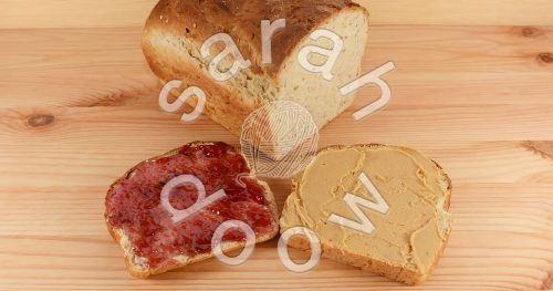 Making peanut butter and jelly sandwiches - stock photos